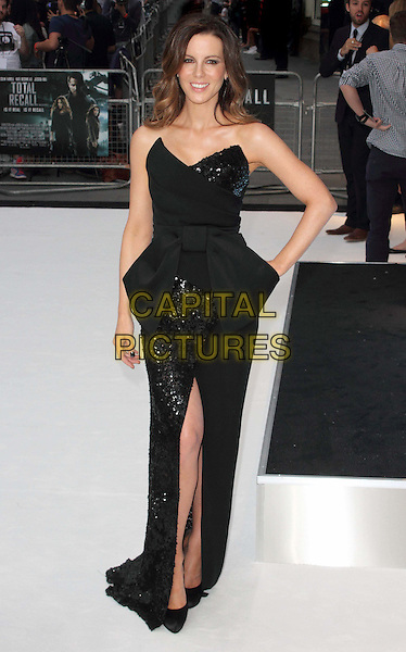 Kate Beckinsale.'Total Recall' UK Film Premiere arrivals, Vue Leicester Square, London, England..August 16th, 2012.full length black dress strapless sequins sequins bow-cinched waist slit split hand on hip .CAP/ROS.©Steve Ross/Capital Pictures.