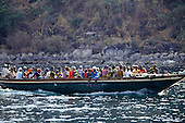 Gombe, Tanzania. Pedestrian ferry boat overloaded with people on Lake Tanganyika.