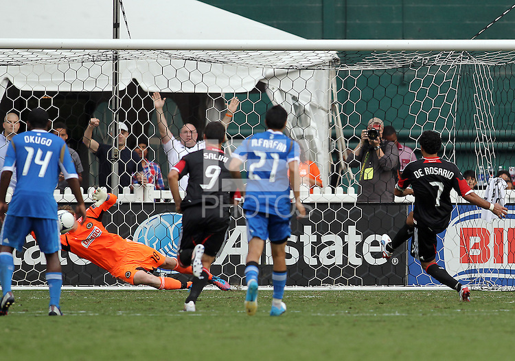 WASHINGTON, D.C. - AUGUST 19, 2012:  Dwayne DeRosario (7) of DC United beats Zac MacMath (18) of the Philadelphia Union from a penalty kick that had to be re-taken during an MLS match at RFK Stadium, in Washington DC, on August 19. The game ended in a 1-1 tie.