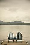 The Birches Resort, Moosehead Lake, ME. 2 adirondack chairs on dock.