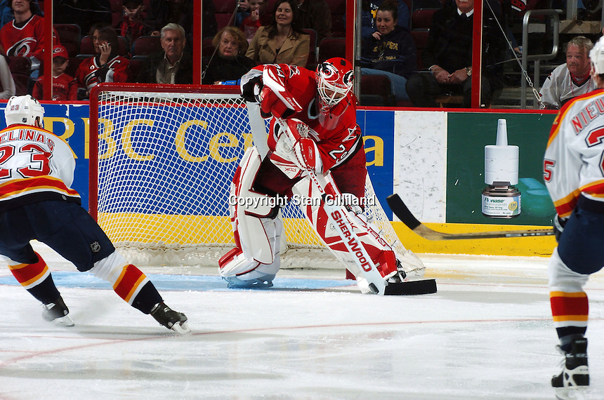 Carolina Hurricanes' goaltender Martin Gerber of Switzerland clears the puck out of his crease during a game with the Florida Panthers Friday, March 3, 2006 at the RBC Center of Raleigh, NC. Carolina won 5-2.