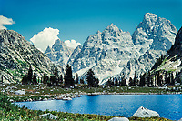 """Lake Solitude and the Grand Teton in the high country of Grand Teton National Park.  A fond memory for my, I shot this back in 1988 when we were still shooting slide film. <br /> <br /> For production prints or stock photos click the Purchase Print/License Photo Button in upper Right; for Fine Art """"Custom Prints"""" contact Daryl - 208-709-3250 or dh@greater-yellowstone.com"""