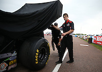 Apr. 27, 2013; Baytown, TX, USA: NHRA crew members for top fuel dragster driver Larry Dixon during qualifying for the Spring Nationals at Royal Purple Raceway. Mandatory Credit: Mark J. Rebilas-