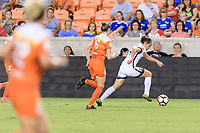 Houston, TX - Saturday July 08, 2017: Ashleigh Sykes races up the field with the ball with Janine Beckie in pursuit during a regular season National Women's Soccer League (NWSL) match between the Houston Dash and the Portland Thorns FC at BBVA Compass Stadium.
