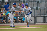 Third baseman Nathan Eaton (8) of the Lexington Legends is greeted by Manager Brooks Conrad after hitting a home run in a game against the Columbia Fireflies on Friday, May 3, 2019, at Segra Park in Columbia, South Carolina. Lexington won, 5-2. (Tom Priddy/Four Seam Images)
