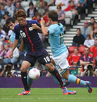 Men's Olympic Football match Spain v Japan on 26.7.12...Keigo Higashi of Japan and Juan Mata of Spain, during the Spain v Japan Men's Olympic Football match at Hampden Park, Glasgow..........