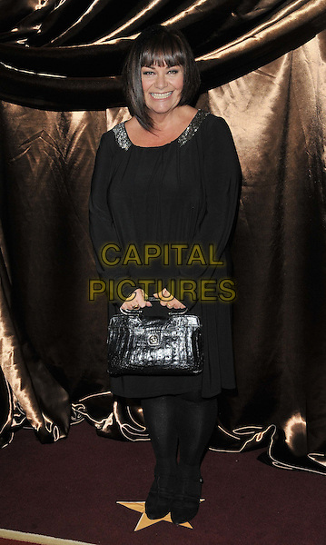 Dawn French .The Galaxy National Book Awards 2011, Mandarin Oriental Hyde Park hotel, Knightsbridge, London, England..November 5th, 2011.full length black top smiling tights handbag purse bag.CAP/CAN.©Can Nguyen/Capital Pictures.