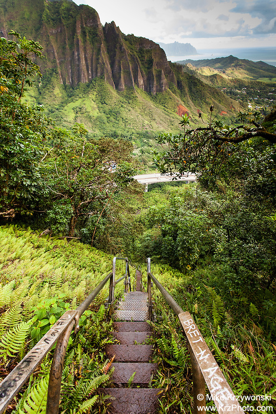 "An aerial view of the  Ko'olau mountain range & H-3 freeway w/ steps descending into Haiku valley at dawn from Haiku Stairs (""Stairway to Heaven"") hiking trail in Kaneohe, Oahu"