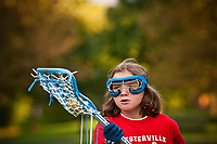 young lacrosse players practice skills and techniques at a lacrosse clinic and practice at a city park in Westerville, OH.