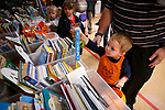 Asher Schober, 3, picks a book at the Friends of the Carson City Library booth at the Carson City Boo-nanza event, in Carson City, Nev., on Tuesday, Oct. 30, 2018. <br /> Photo by Cathleen Allison/Nevada Momentum