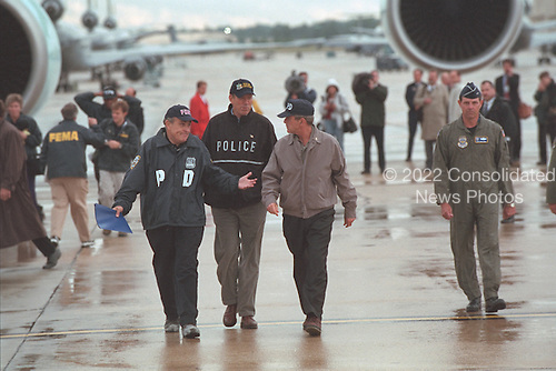 United States President George W. Bush arrives at McGuire Air Force Base in Wrightstown, New Jersey with New York City Mayor Rudolph Giuliani and Governor George Pataki, Friday, September 14, 2001..Mandatory Credit: Eric Draper - White House via CNP.