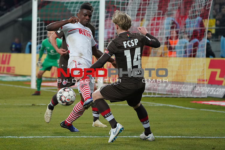 08.02.2019, RheinEnergieStadion, Koeln, GER, 2. FBL, 1.FC Koeln vs. FC St. Pauli,<br />  <br /> DFL regulations prohibit any use of photographs as image sequences and/or quasi-video<br /> <br /> im Bild / picture shows: <br /> Jhon C&oacute;rdoba (FC Koeln #15),   im Zweikampf gegen  Mats M&ouml;ller / Moeller Daehli (St Pauli #14), <br /> <br /> Foto &copy; nordphoto / Meuter