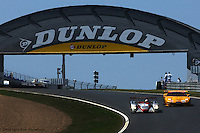 LE MANS, FRANCE: The Audi Sport Team Joest Audi R8 601 of Emanuele Pirro, Tom Kristensen and Frank Biela leads the Corvette Racing Chevrolet Corvette C5-R 003 of Johnny O'Connell, Ron Fellows and Oliver Gavin during the 24 Hours of Le Mans on June 16, 2002, at Circuit de la Sarthe in Le Mans, France. These cars won their respective classes in the event.