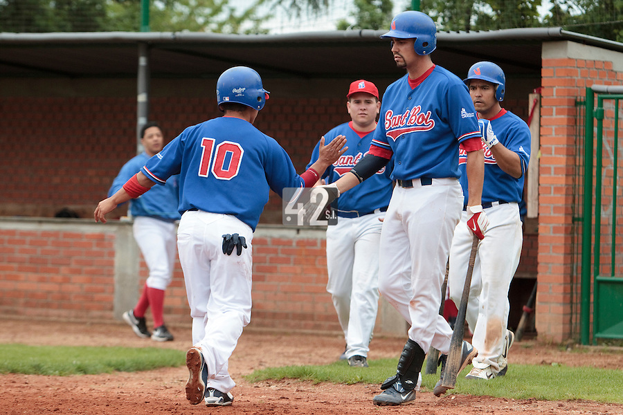 03 June 2010: Daniel Sanchez of C.B. Sant Boi is congratulated by his teammates after scoring on a home run during the 2010 Baseball European Cup match won  8-4 by C.B. Sant Boi over the Rouen Huskies, at the Kravi Hora ballpark, in Brno, Czech Republic.