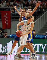 Real Madrid's Martynas Pocius (f) and BC Khimki MR's Sergey Monya (c) and Kresimir Loncar (b) during Euroleague 2012/2013 match.November 23,2012. (ALTERPHOTOS/Acero) /NortePhoto