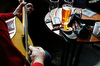 Sunday session at the Cobblestone Bar, Smithfield, Dublin, Ireland.<br /> <br /> The Cobblestone has long been a bastion of the intimate old style music venue and is possibly Dublin's best traditional Irish music bar. The d&eacute;cor has all the charm and musty elegance of a country pub. The Cobblestone holds gigs throughout the week hosting some of the country's finest traditional and roots musicians and front bar always has a reserved section for any musician who wants to play.