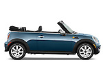 Passenger side profile view of a 2010 Mini Cooper Convertible.