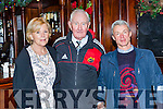 Catherine and Denis Brosnan and David Blennerhasset at the Castleisland Rugby club Con Houlihan Christmas concert in the River Island Hotel on Saturday night