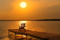 Muskoka chair on dock at Clear Lake<br /> Riding Mountain National Park<br /> Manitoba<br /> Canada
