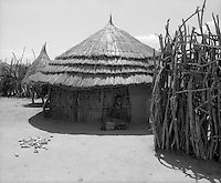 Karamoja, Uganda , Africa. - Village buildings  and grain bins