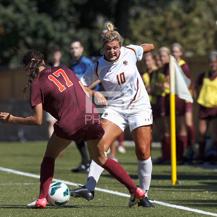 Boston College midfielder Gibby Wagner (10) works to retain control of the ball.Virginia Tech (maroon) defeated Boston College (white), 1-0, at Newton Soccer Field, on September 22, 2013.