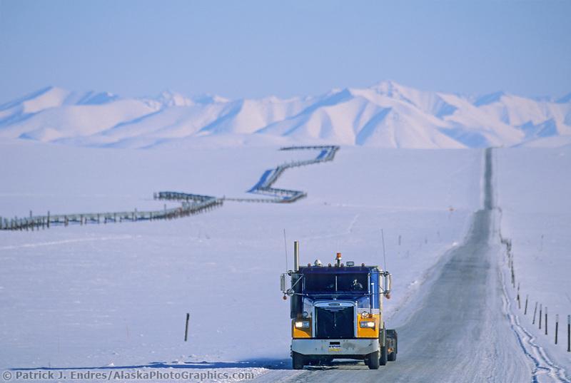 Semi truck travels the James Dalton Highway, Philip Smith Mountains, Brooks Range, Trans Alaska Pipeline, Arctic, Alaska