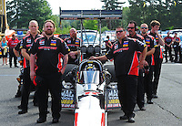 Aug. 7, 2011; Kent, WA, USA; Crew members for NHRA top fuel dragster driver David Grubnic during the Northwest Nationals at Pacific Raceways. Mandatory Credit: Mark J. Rebilas-