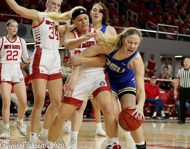 VERMILLION, SD - JANUARY 19: Tori Nelson #20 of the South Dakota State Jackrabbits tries to control the ball as Madison McKeever #23 of the South Dakota Coyotes grabs her arm at the Sanford Coyote Center on January 19, 2020 in Vermillion, South Dakota. (Photo by Dave Eggen/Inertia)