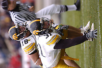 23 October 2004:  Iowa DE Matt Roth (31) and LB Chad Greenway (18).<br />