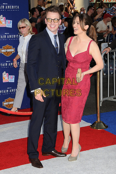 "Chris Evans & Hayley Atwell.Premiere of ""Captain America: The First Avenger"" held at The El Capitan Theatre in Hollywood, California, USA..July 19th, 2011.full length suit dress pink waistcoat smiling profile glasses black blue suit .CAP/ADM/BP.©Byron Purvis/AdMedia/Capital Pictures."