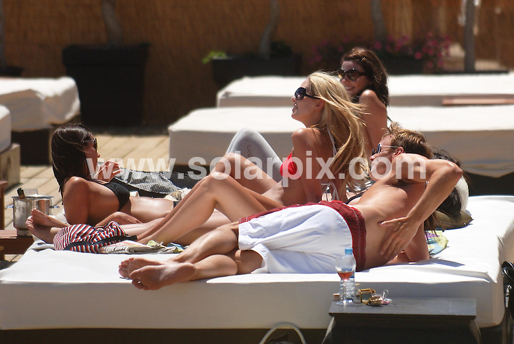 **ALL ROUND EXCLUSIVE PICTURES FROM SOLARPIX.COM**.**WORLDWIDE SYNDICATION RIGHTS**.Former England striker Teddy Sheringham showed no signs of stress as he was chatted up by scores of girls as he relaxed around a pool in Marbella. (We count 6 girls on his bed!!) It has been claimed that he gave false details to police about an alleged speeding offence and ex-West Ham forward, who was made an MBE last week, has been bailed to return in July for further inquiries..JOB REF:  4101     JGS        DATE: 19.06.07.**MUST CREDIT SOLARPIX.COM OR DOUBLE FEE WILL BE CHARGED* *UNDER NO CIRCUMSTANCES IS THIS IMAGE TO BE REPRODUCED FOR ANY ONLINE EDITION WITHOUT PRIOR PERMISSION*