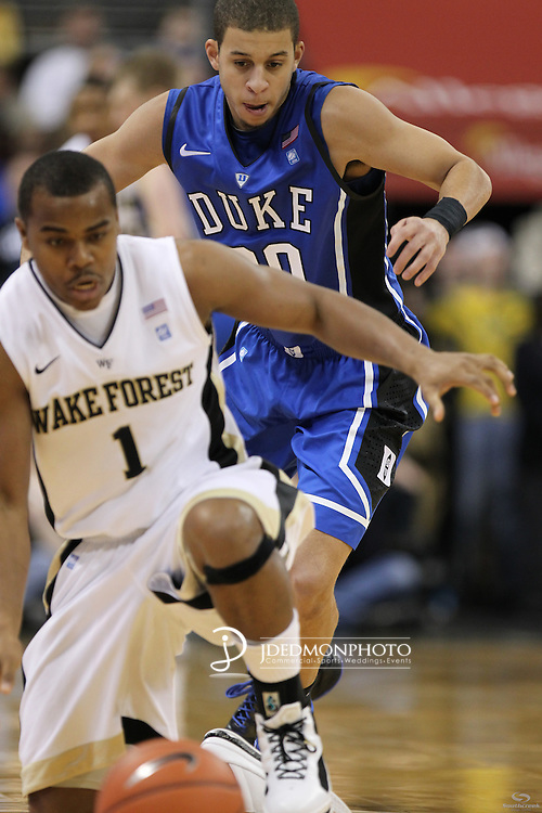 Wake Forest Demon Deacons guard Tony Chennault (1) scrambles for the loose ball after being tipped out by Duke Blue Devils guard Seth Curry (30). Duke wins 83-59..