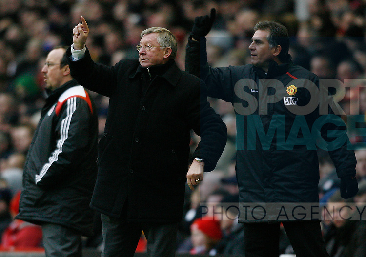 Manchester United manager and assistant Sir `Alex ferguson and Carlos Quieroz give instructions next to Liverpool manager rafael Benitez