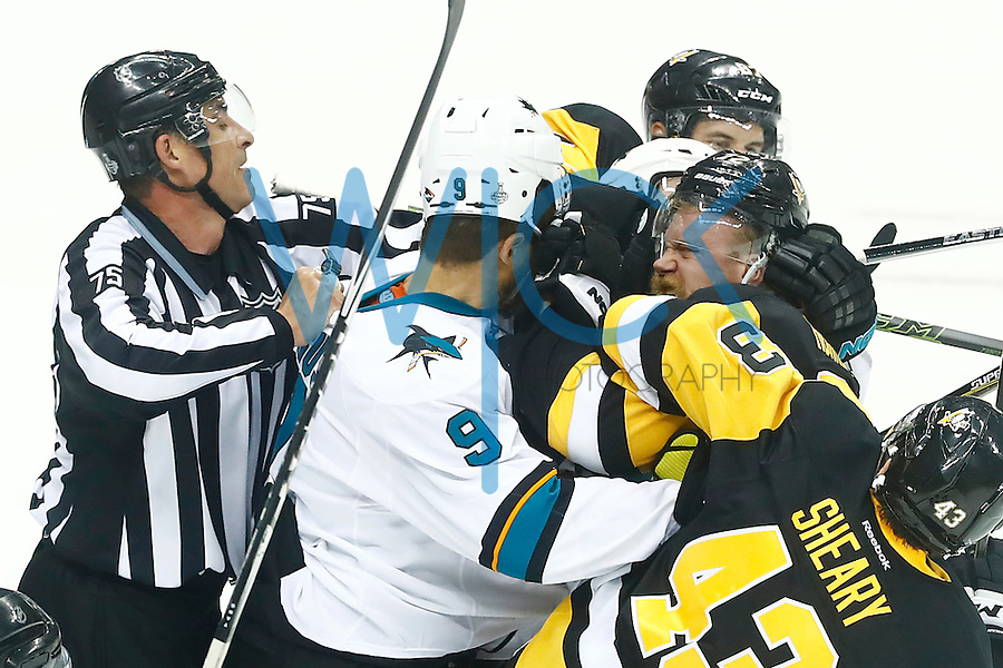 Patric Hornqvist #72 of the Pittsburgh Penguins gets in a fight with Dainius Zubrus #9 of the San Jose Sharks in the second period during game five of the Stanley Cup Final at Consol Energy Center in Pittsburgh, Pennsylvania on June 9, 2016. (Photo by Jared Wickerham / DKPS)