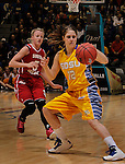 SIOUX FALLS, SD - MARCH 12:  Tara Heiser #12 of South Dakota State stops as Alexis Yackley #5 of the University of South Dakota catches up during their championship game at the 2013 Summit League Tournament at the Sioux Falls Arena Tuesday. (Photo by Dick Carlson/Inertia)