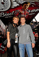 Oct. 11, 2009; Fontana, CA, USA; NASCAR Sprint Cup Series driver Kasey Kahne (right) poses for a photo with actress Audrina Patridge prior to the Pepsi 500 at Auto Club Speedway. Mandatory Credit: Mark J. Rebilas-