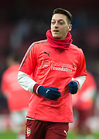 Mesut Ozil of Arsenal warms up during the Premier League match between Arsenal and Newcastle United at the Emirates Stadium, London, England on 16 December 2017. Photo by Vince  Mignott / PRiME Media Images.