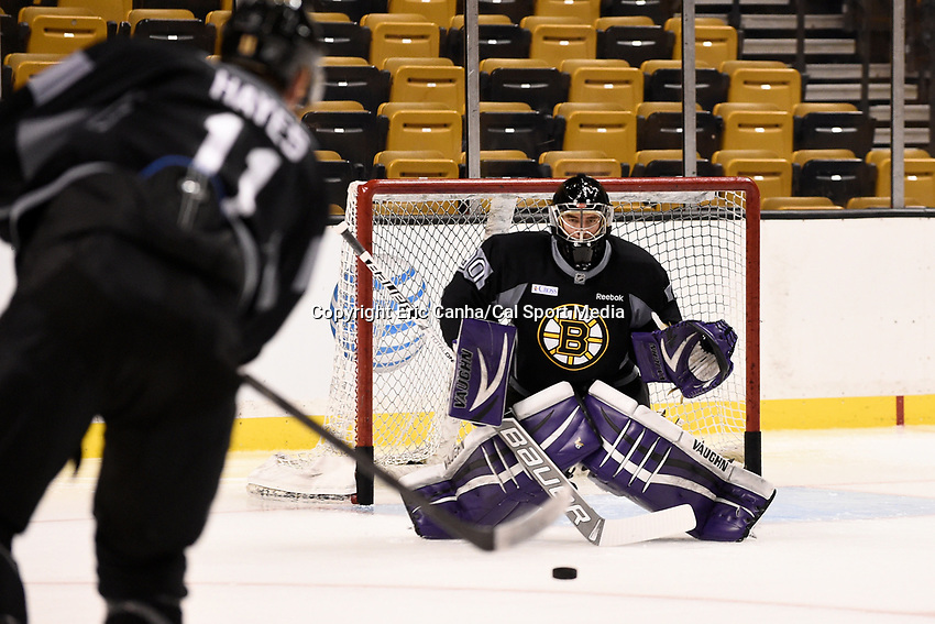 September 18, 2015 - Boston, Massachusetts, U.S. - Boston Bruins goalie Matthew Ginn (90) defends against a shot from right wing Jimmy Hayes (11) during the Boston Bruins training camp held at TD Garden in Boston Massachusetts. Eric Canha/CSM