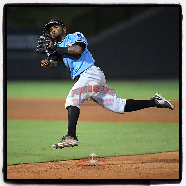 Second baseman Yonny Hernandez (1) of the Hickory Crawdads takes to the air to throw out a runner in a game against the Greenville Drive on Monday, July 23, 2018, at Fluor Field at the West End in Greenville, South Carolina. Hickory won, 6-1. (Tom Priddy/Four Seam Images)