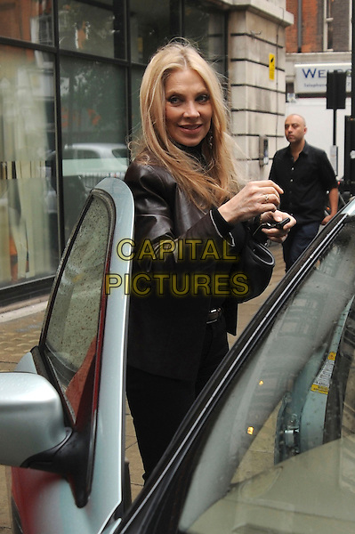 Singer / songwriter Lynsey De Paul has died at the age 64 following suspected brain haemorrhage. She represented the UK in the 1977 Eurovision Song Contest and was best known for her hits Sugar Me and Won't Somebody Dance With Me.<br /> STOCK PHOTO: LYNSEY DE PAUL <br /> Pictured in Great Portland Street,  London, England, UK,<br /> 26th October 2010.<br /> half length black brown leather jacket hand getting into car <br /> CAP/IA<br /> &copy;Ian Allis/Capital Pictures
