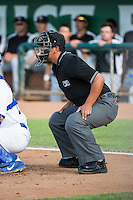 Umpire Luis Hernandez handles the calls behind the plate during the Pioneer League game between the Ogden Raptors and the Grand Junction Rockies at Lindquist Field on July 6, 2015 in Ogden, Utah. Ogden defeated Grand Junction 8-7.  (Stephen Smith/Four Seam Images)