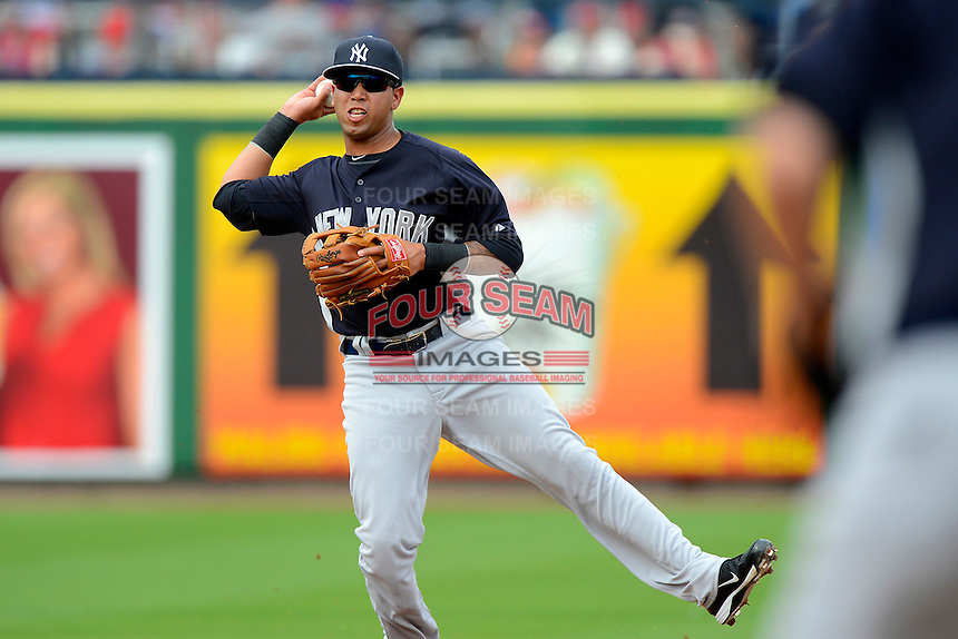 New York Yankees shortstop Cito Culver #90 fields a grounder during a Spring Training game against the Philadelphia Phillies at Bright House Field on February 26, 2013 in Clearwater, Florida.  Philadelphia defeated New York 4-3.  (Mike Janes/Four Seam Images)