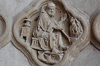 Quadrilobe depicting a man in front of a fire, cooking and heating his hands, under the sign of the Zodiac Piscies to figure the agricultural work during the month of February and March, Saint Firmin's portal, Amiens Cathedral, 13th century, Amiens, Somme, Picardie, France. Picture by Manuel Cohen