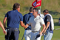 Phil Mickelson (USA) shakes hands with Rory McIlroy (NIR) after finishing on the 18th green during the second round of the 118th U.S. Open Championship at Shinnecock Hills Golf Club in Southampton, NY, USA. 15th June 2018.<br /> Picture: Golffile | Brian Spurlock<br /> <br /> <br /> All photo usage must carry mandatory copyright credit (&copy; Golffile | Brian Spurlock)