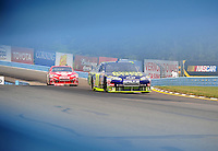 Aug. 8, 2009; Watkins Glen, NY, USA; NASCAR Sprint Cup Series driver Andy Lally leads Juan Pablo Montoya during practice for the Heluva Good at the Glen. Mandatory Credit: Mark J. Rebilas-