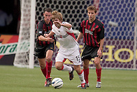 D.C. United's Bobby Convey battles for the ball with the MetroStars' Mark Lisi as Mike Magee watches. D. C. United was defeated by the NY/NJ MetroStars 3 to 2 during the MetroStars home opener at Giant's Stadium, East Rutherford, NJ, on April 17, 2004.