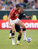John O'Shea (22) of Manchester United fights for the ball with Fred (7) of Philadelphia Union during a friendly match at Lincoln Financial Field in Philadelphia, Pennsylvania.  Manchester United defeated Philadelphia Union, 1-0.