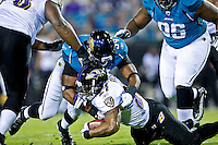 October 24, 2011:  Baltimore Ravens running back Ray Rice (27) is tackled by Jacksonville Jaguars defensive end Jeremy Mincey (94) during first quarter action between the Jacksonville Jaguars and the Baltimore Ravens played at EverBank Field in Jacksonville, Florida.  ........