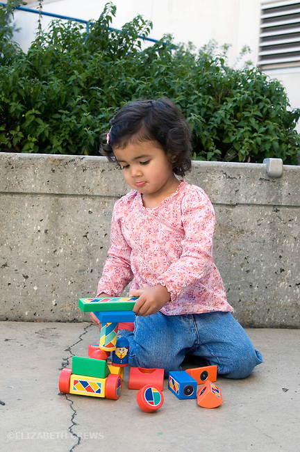 Berkeley CA Girl, two and a half, half Nepalese, building with magnetic blocks  MR