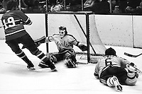 Seals vs Montreal (1973)#19 Larry Robinson on goal against Gilles Meloche, Bob Stewart on ice. (1973 photo by Ron Riesterer)